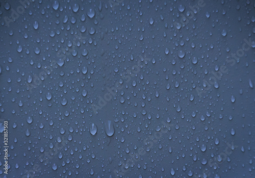 Drops of water on blue background Wallpaper Mural