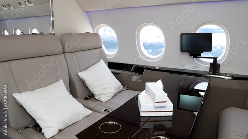Fototapeta Cabin seats in a business jet flight