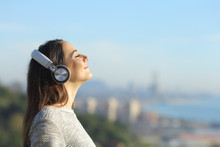 Woman Listening To Music Breat...