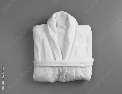 Photo Clean folded bathrobe on grey background, top view