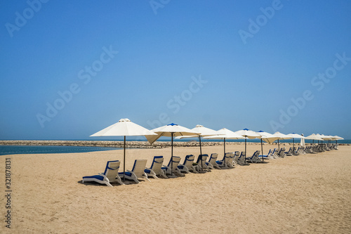 Beach umbrellas are in one line Canvas Print