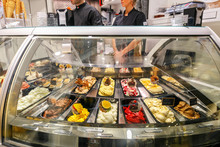 Refrigerated Display Case With A Large Assortment Of Soft Ice Cream In An Italian Store
