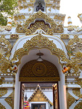 Temple In Chiangmai Thailand Beautifully Decorated With Wonderful Colours Statues Of Buddha, Payanak, And Monks On Walking Street In The Old City