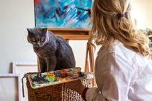 Woman And Her Pet In Art Studi...