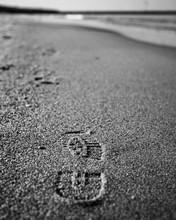 A Footprint On The Soles Refle...