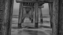 Black And White Setting Over Naples Beach, Shot Under Its Iconic Pier, Naples Pier, Florida. Black, USA