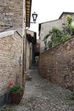Fototapeta Uliczki - narrow street in old town Montefalco Italy