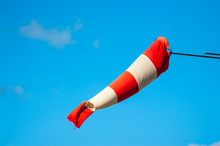 Windsock Against Blue Sky
