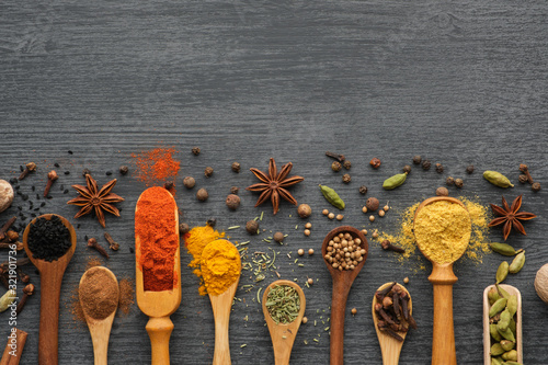 Fotografija Various aromatic colorful spices and herbs in wooden spoons and scoops