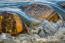 Water Flowing Over Rocks In Th...
