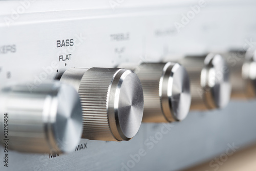 Control Knobs on a Silver Metallic vintage Amplifier - Shallow Depth of Field Wallpaper Mural