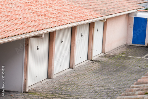 Fotografie, Obraz Row of parking garages at building apartment parked private