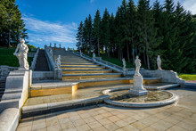 Ancient Stairs With White Steps And Graceful Sculptures