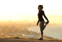 Runner Stretching Leg In City ...