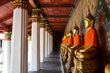 Buddahist Temple Columms And A Gold Buddha Sculpture. Chedi Buddhist Temple
