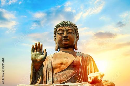 The big Tian Tan Buddha at Po Lin Monastery in Hong Kong during sunset Wallpaper Mural