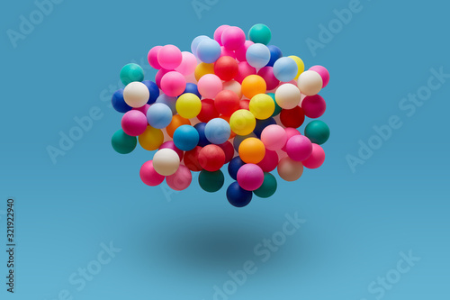 Colorful balls levitation in mid air on blue background Fototapet