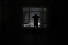 Silhouette Of A Man Standing A...