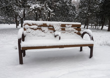 A Bench Covered By Snow In A Park Of Beijing