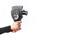 Female Hand Holding Old Style 8 Mm Movie Camera On A White Background