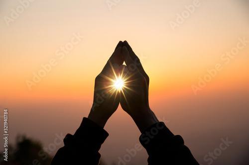 Leinwand Poster Silhouette of christian man hand praying