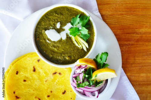 A dish of sarson ka saag spinach stew at an Indian restaurant Wallpaper Mural