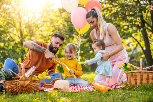 Fototapeta Family on picnic at sunny day.