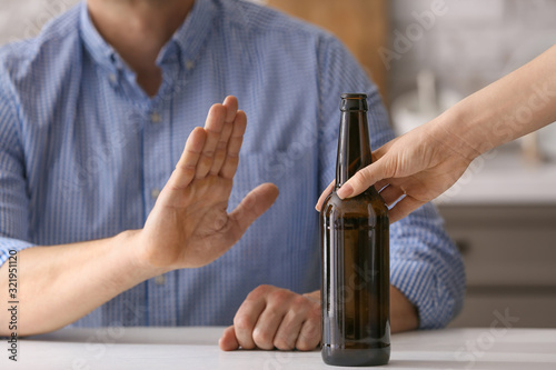 Man refusing to drink beer at home. Concept of alcoholism Canvas-taulu