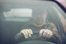 War Veteran Driving A Car With Prosthetic Hand