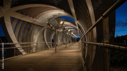 Inside the spectacular Arganzuela footbridge enclosed with spiraling metal desig Canvas Print