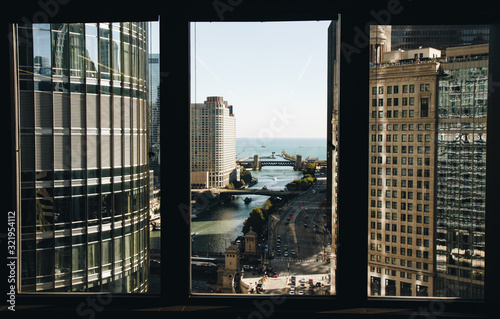 city view looking through window at a river and lake