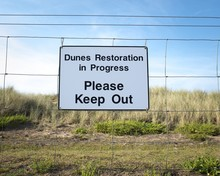 Closeup Shot Of A Sign On A Wi...