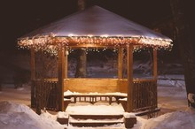 Wooden Gazebo Covered With Sno...