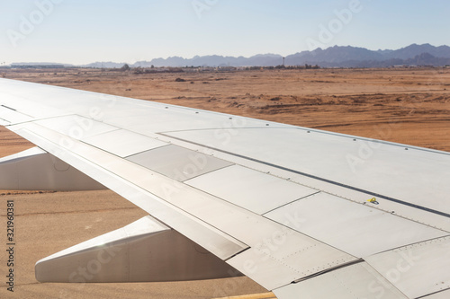 The plane lands on the airfield Canvas Print