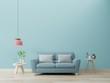 canvas print picture - Modern living room interior with sofa and green plants,lamp,table on blue wall background.