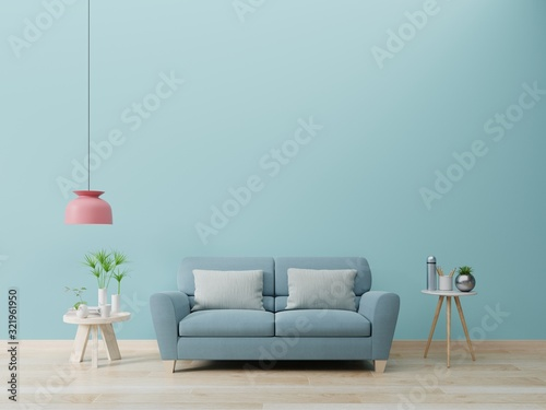 Photo Modern living room interior with sofa and green plants,lamp,table on blue wall background