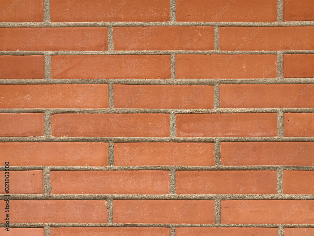 orange colored wall brick Abstract grunge background with distressed aged texture and brush painting