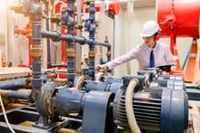 Engineer Checking Condenser Wa...