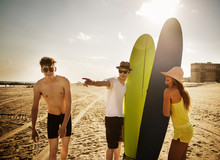 Friends On The Beach With Surf...