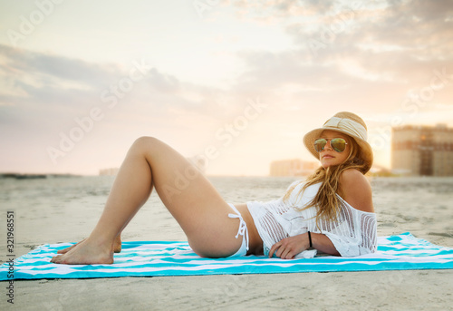Woman relaxing on the beach - 321968551