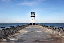 Lighthouse On Coast Of Sea