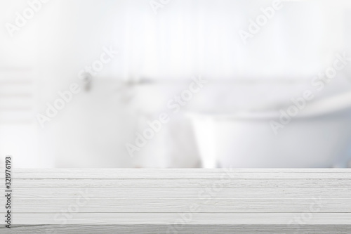 Obraz Empty wooden top table with blurred bathroom background. - fototapety do salonu
