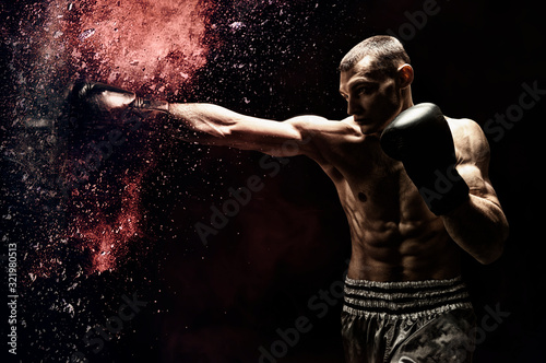 Professional boxer hits the bag Fototapet