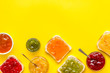 canvas print picture - Toast with colorful fruit jam frame on yellow background frame copy space