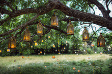 Evening Wedding Ceremony With A Lot Of Vintage Lanterns, Lamps, Candles. Unusual Outdoor Ceremony Decoration. Beautiful Garden Party Concept.