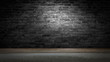 Leinwanddruck Bild - background of an empty black room, a cellar, lit by a searchlight. Brick black wall and wooden floor