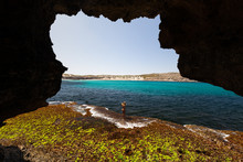 View From Cave Of Woman In Bik...
