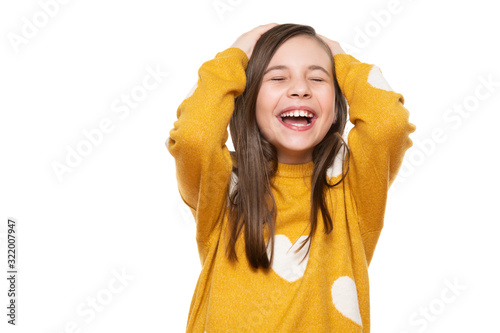 Fototapeta Waist up studio portrait of an adorable young girl laughing with excitement, head in hands and closed eyes, isolated on white backgroud. Human emotions and facial expressions concept. obraz