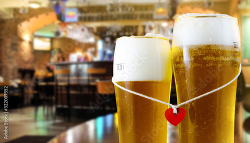 Fotografie, Obraz Two glasses of beer for lovers with red heart