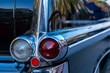 Closeup shot fo the headlights of an antique silver car
